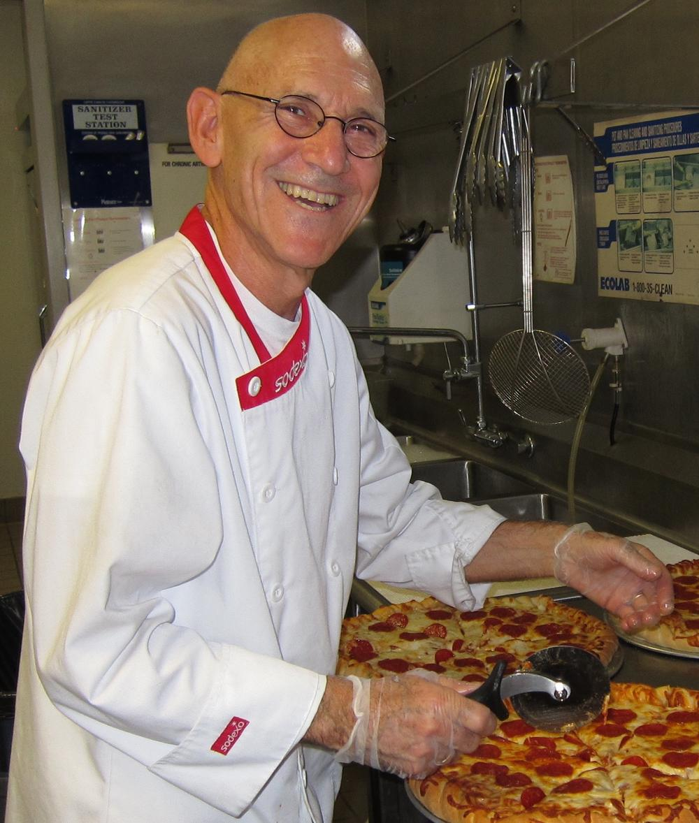 chef cutting pizza